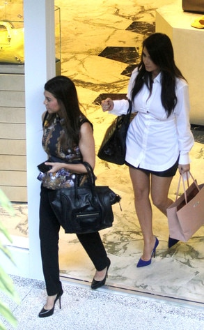 Kim Kardashian,Courtney Krdashian - Shopping in Miami