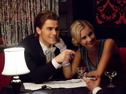 Paul Wesley as Stefan and Claire Holt as Rebekah on THE VAMPIRE DIARIES