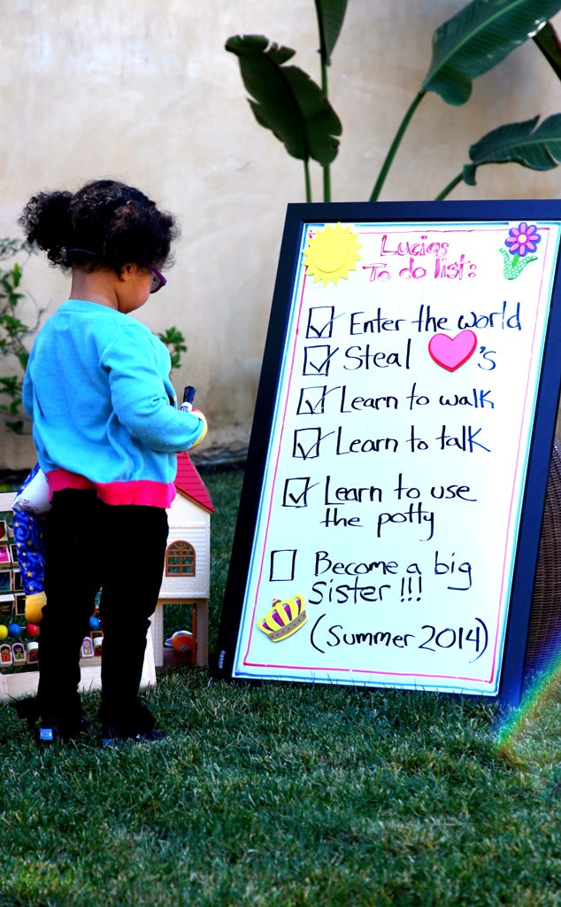 "In March 2014, the lovely couple Eric Benet and his wife Manuel Testolini confirmed the news about their third child with a picture of Lucia standing in front of a ""to do"" list"