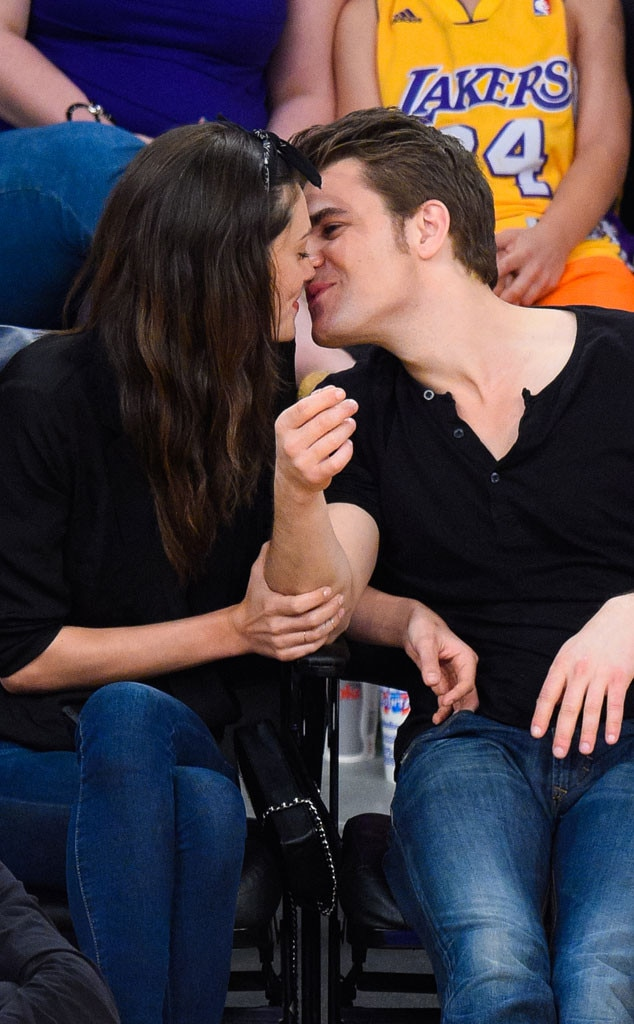 Paul Wesley and Phoebe Tonkin kissing