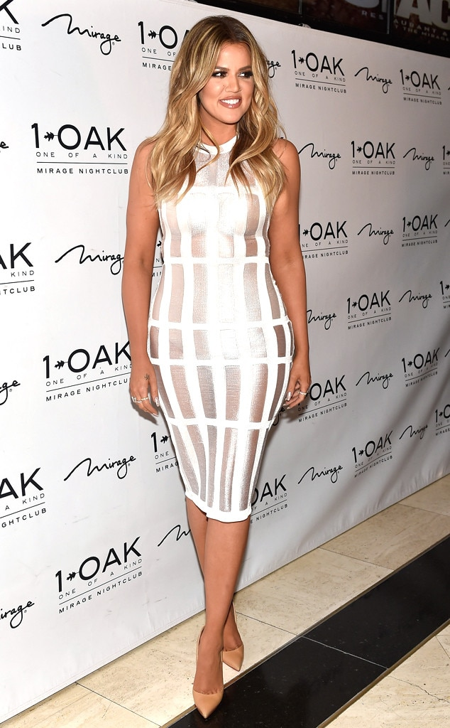 Khlo kardashian shows skin in white cage dress was she for How to dress like khloe kardashian
