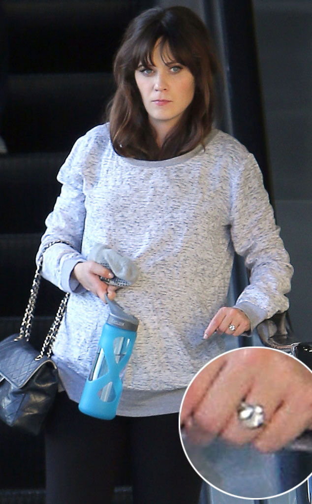 Zooey Deschanel showing her engagement ring and baby bump