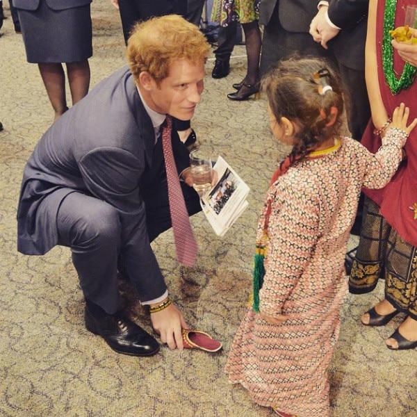 Prince Harry Plays Prince Charming While Meeting Adorable