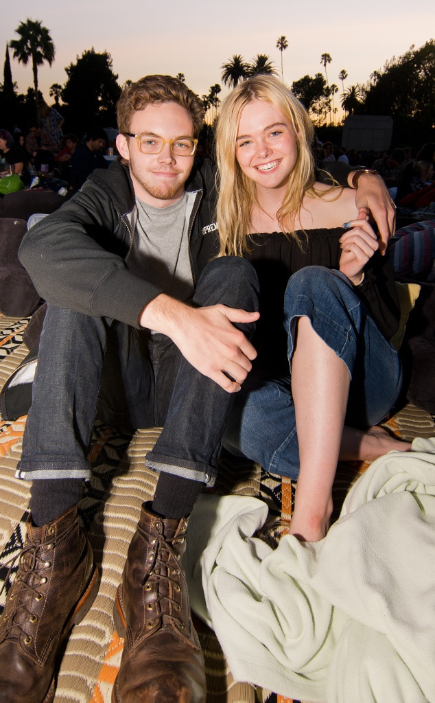 Elle Fanning Cuddles Up To Zalman Band While Taking In A
