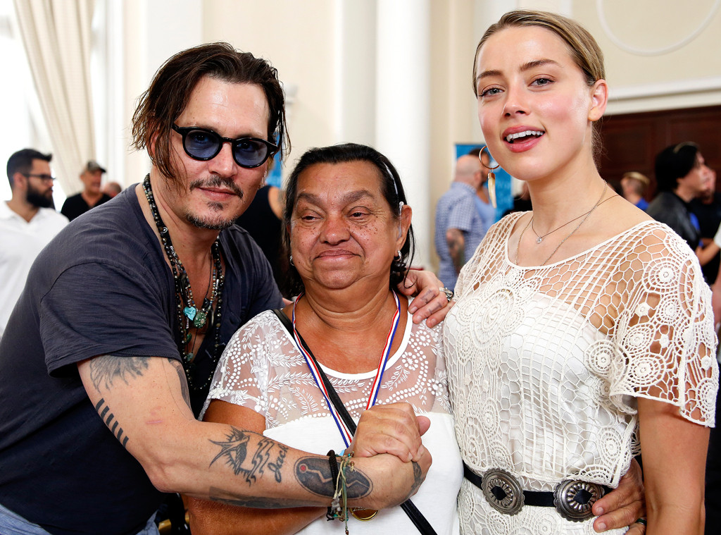Johnny Depp and Amber Heard Distribute Hearing Aids to ...