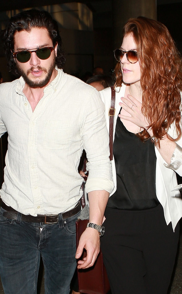 Kit Harington and Rose Leslie holding hands