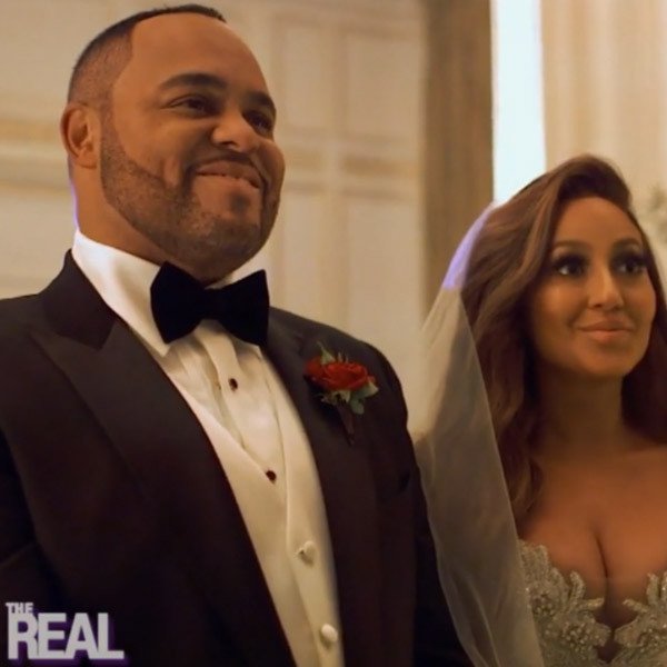 Watch Adrienne Bailon And Israel Houghton Kiss For The