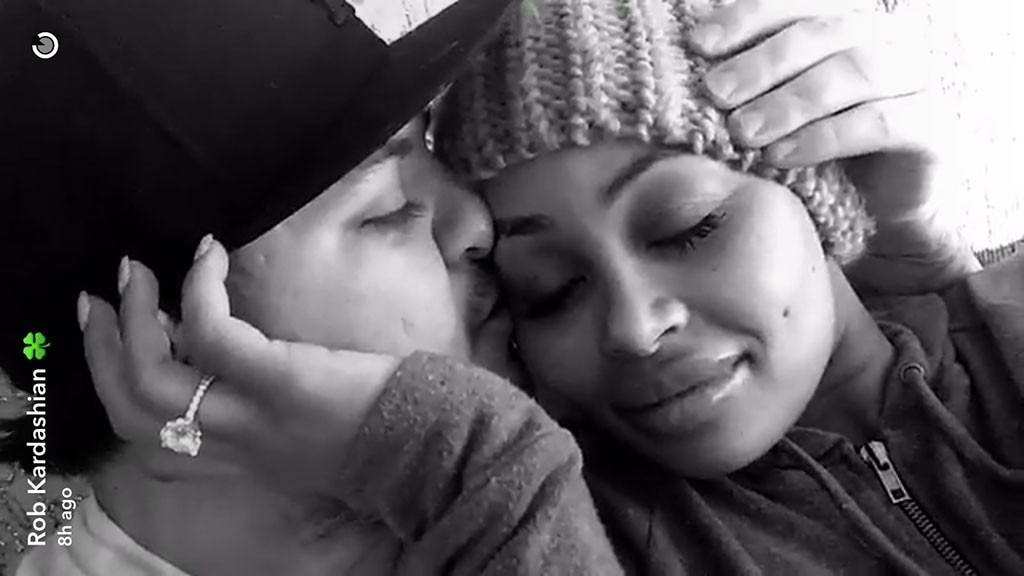 Blac Chyna and Rob Kardashian literally roll around kissing in $100 bills