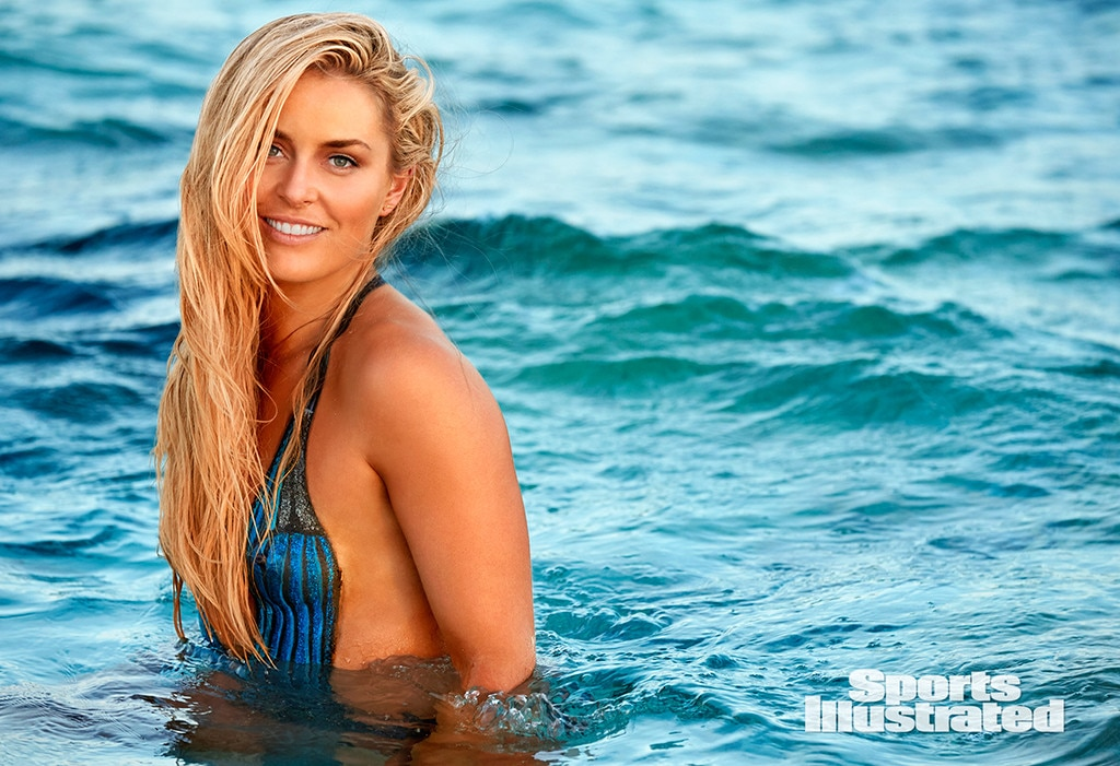 ... , Wearing Only Body Paint in Sports Illustrated 's Swimsuit Edition