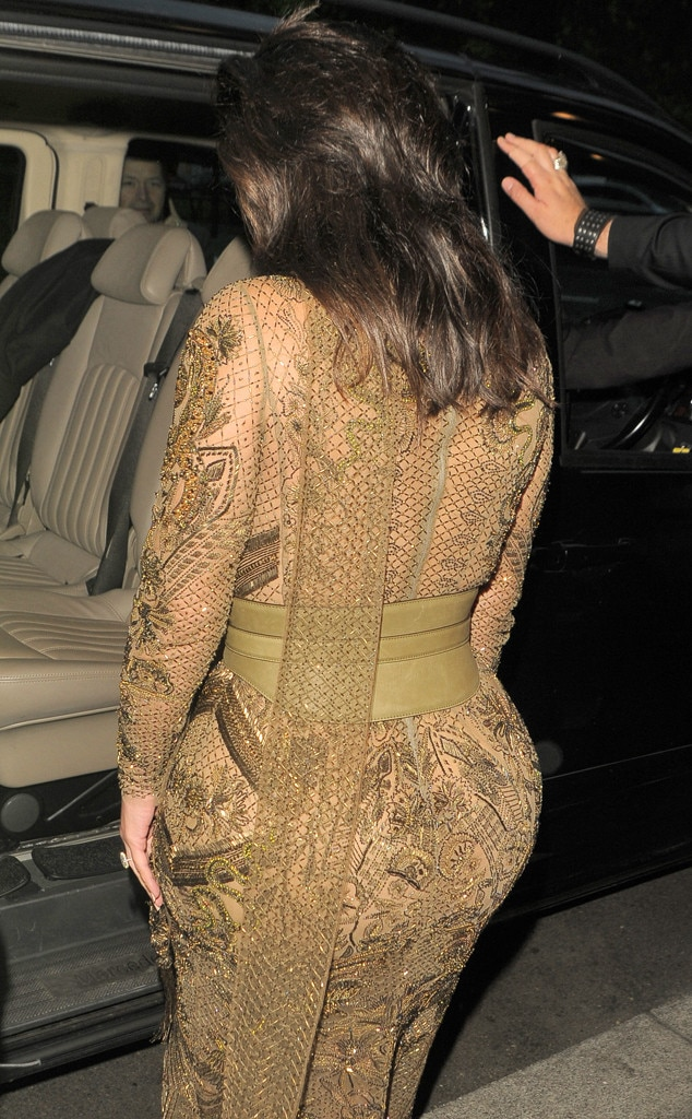 Kim Kardashian Shows Off Her Curves in Flesh-Baring Outfit