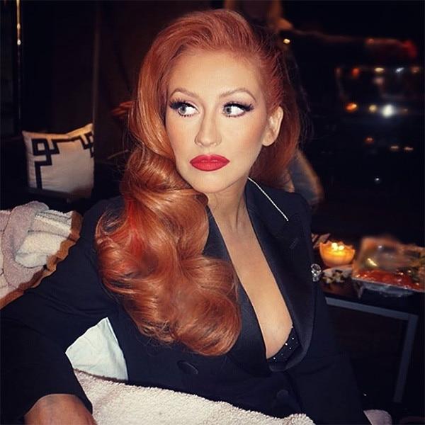 Redhead behind hilary clinton