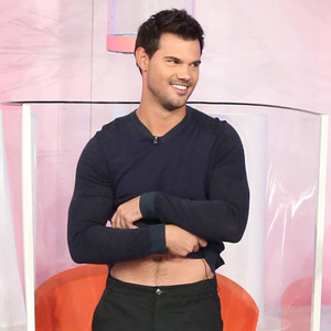 Taylor Lautner Flashes His Abs Before Getting Soaked on TV