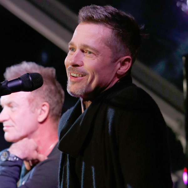 Brad Pitt Is All Smiles at Post-Split Charity Rock Event Appearance