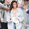 ESC: Kim Kardashian, Rain Boots