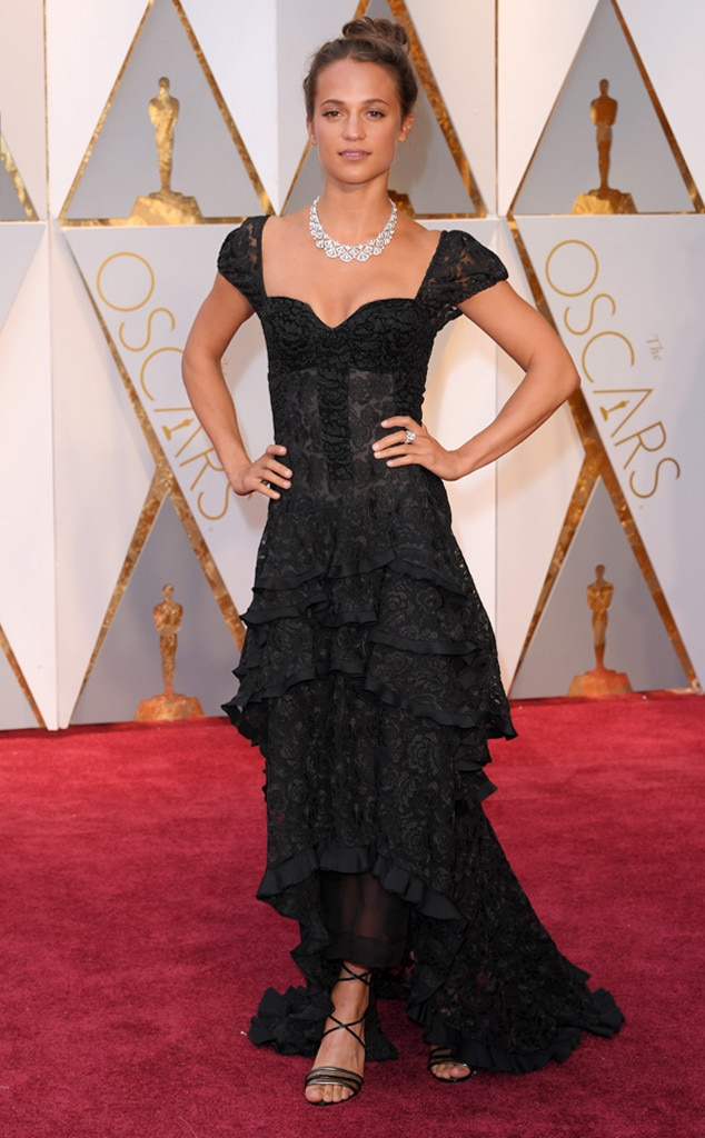 Alicia Vikander: This gorgeous, romantic Louis Vuitton gown looks impeccable on her, the simple tiered lace and ruffle detail makes a large statement. She made a great choice with the minimal makeup and bold diamond necklace