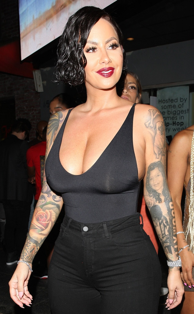 Amber Rose Is Unrecognizable As She Parties In A Black Wig