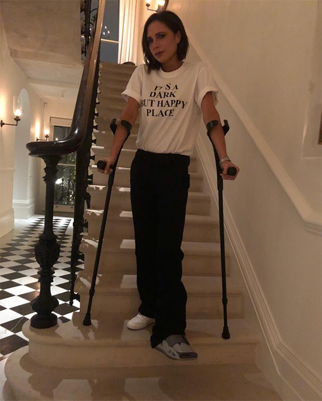 Victoria Beckham Trades Heels For Crutches After Suffering
