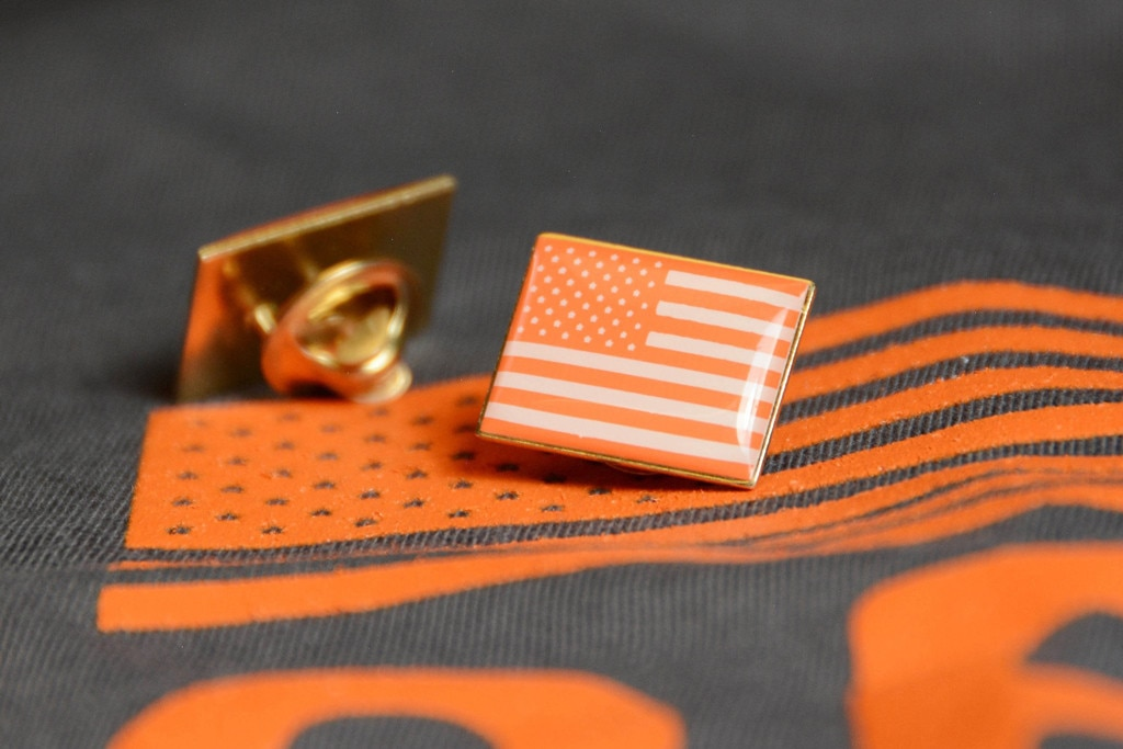 Orange-hued American flag pins for gun safety campaign at Oscars
