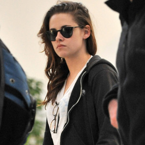 Kristen Stewart arrives at LAX behind a pair of sunglasses.