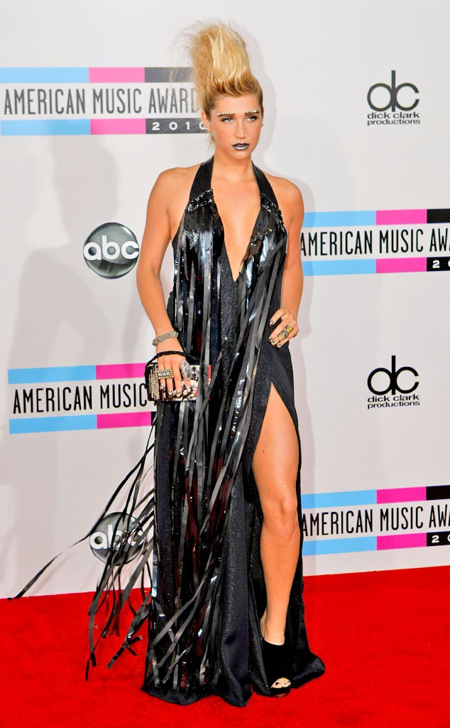 Kesha -  We can't decide what's more wild about this 2010 VMA look, her Mohawk hairstyle, her VHS-tape dress or her studded eyebrows?