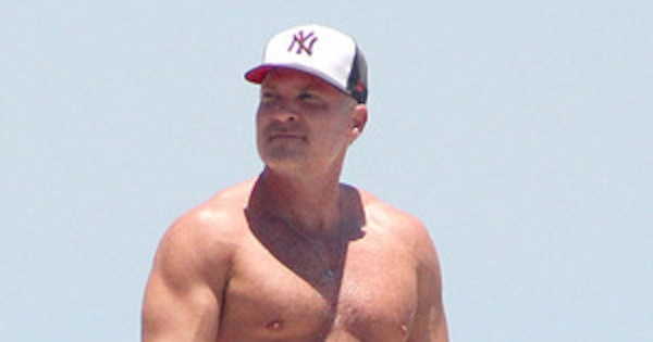 Shirtless Sam Champion Shows Off Washboard Abs During