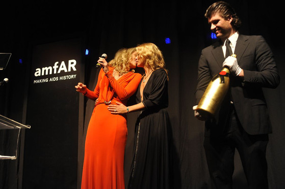 Sharon Stone kisses Kate Moss - amfAR ball in Sao Paulo, Brazil