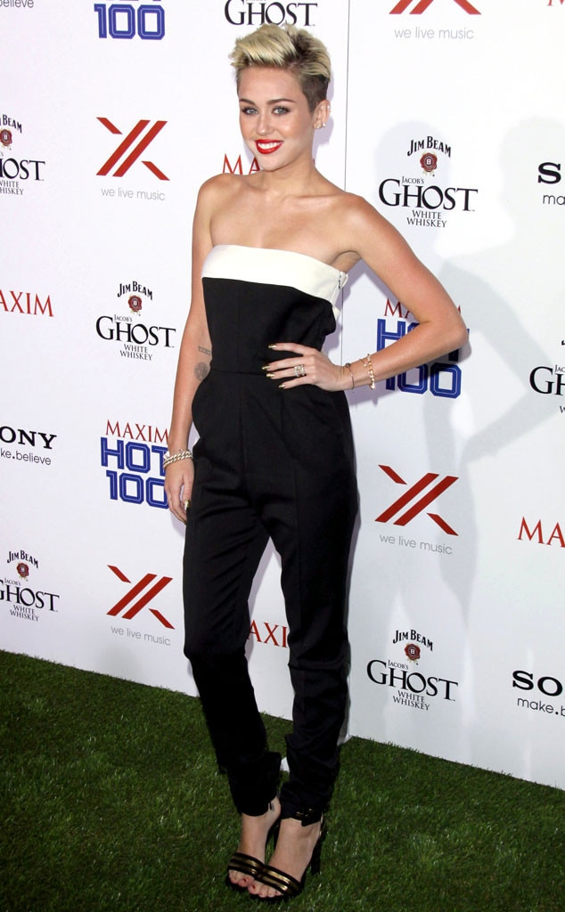 Jumpsuit Junky -  The young entertainer wears a strapless Valentino jumpsuit with a white neckline to the Maxim Hot 100 party. To complete her look she adds sleek Saint Laurent heels.
