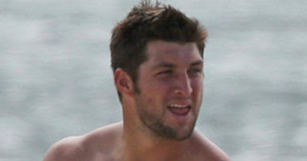 Tim Tebow was spotted being oiled up by his sister Katie