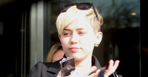 710be69756fc Miley Cyrus Is a Chic Chanel Bag Lady With New Hair—See the Pic! | E! News