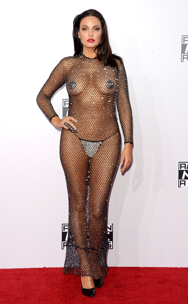 Singer Bleona Qereti -  This is at the 2014 VMAs, but the see through fishnet dress is giving us major Rose McGowan 1998 VMA vibes!
