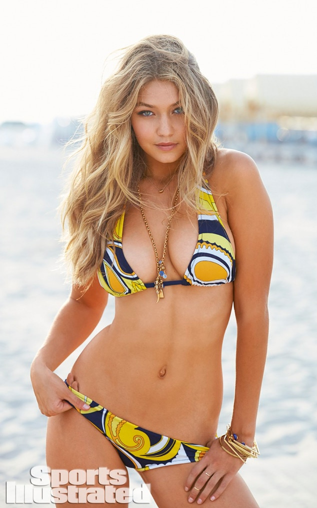 "Beach Babe -  Gigi made her   Sports Illustrated Swimsuit Issue debut in 2014  under the ""rookie"" umbrella ."