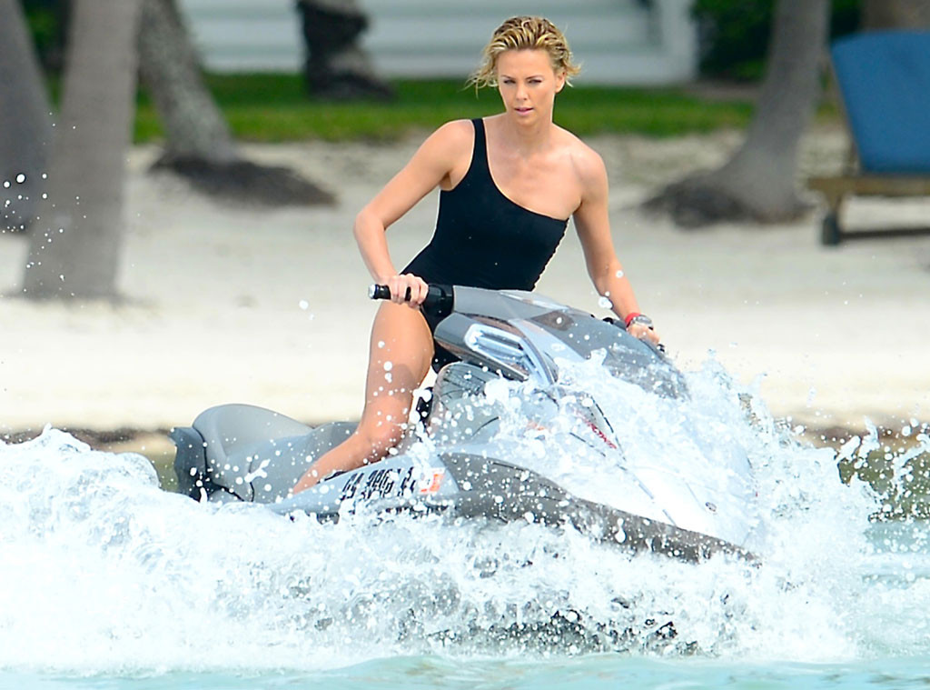Charlize Theron Rides Jet Ski In A Sexy One Piece See The