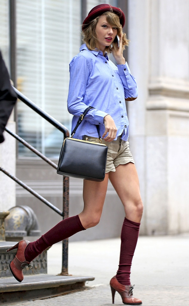 Street Style Chic - While running errands  in April 2014, the young superstar stepped out of her apartment in a matching red Fedora hat, leggings and heels that complemented her button-down blue shirt and tan short-shorts.