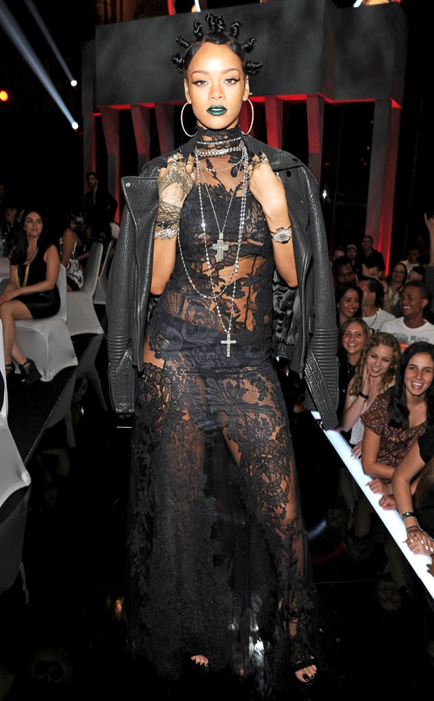 "Rihanna -  Not one to stick to the basics, the ""Love on the Brain"" singer serves goth glam vibes with her lace black gown and snake-green lipstick."