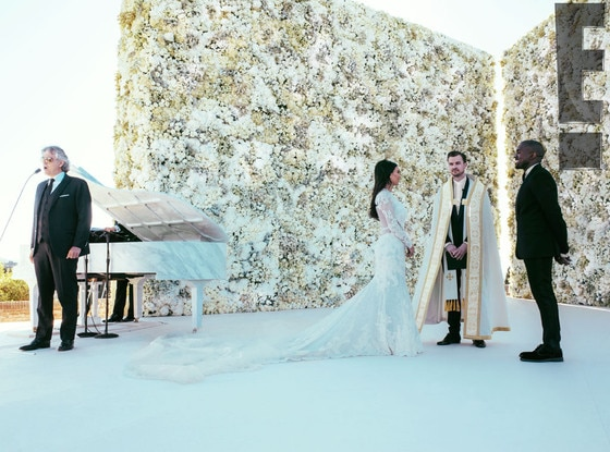 "Music to Their Ears -  Kanye surprised Kim by having Italian star tenor Andrea Bocelli serenade the wedding party. He sang ""Ave Maria"" as Kim walked down the aisle, as well as his hit "" Con te partirò."""