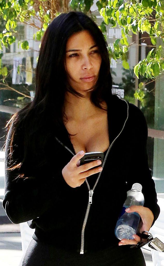Kim Kardashian Flaunts Cleavage While Going Makeup-Free ...