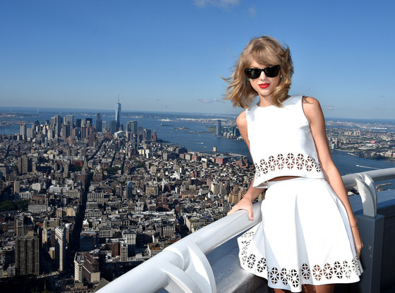 59d494a5ffd Taylor Swift Reveals Newest Single Wearing White Crop Top Outfit—All ...