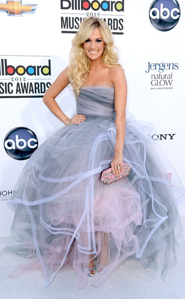 Carrie Underwood -  As always, Carrie is a red carpet vision in this frothy Oscar de la Renta princess gown back in 2012.