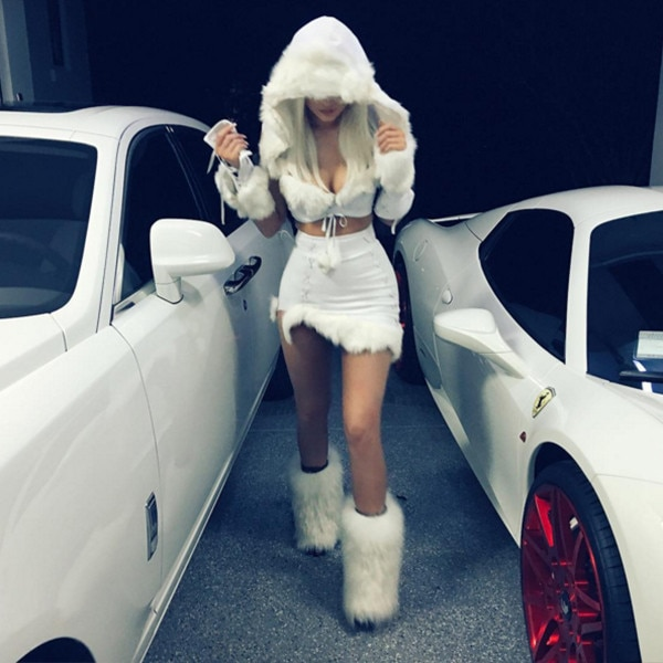 Let It Snow -  In 2015, Jenner channels her inner snow princess in a sexy white two-piece and furry boots.