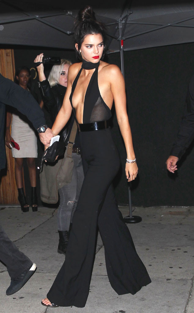 Kendall Jenner Stuns In A Plunging Jumpsuit While Celebrating Her