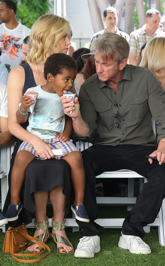 Sean Penn Charlize Therons Son Jackson Share A Snow Coneand Its