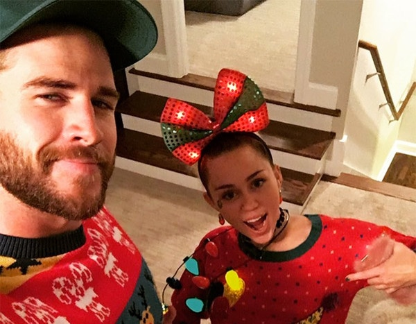 miley cyrus liam hemsworth attend his familys holiday party and wear zany christmas sweaters e news - Miley Cyrus Christmas