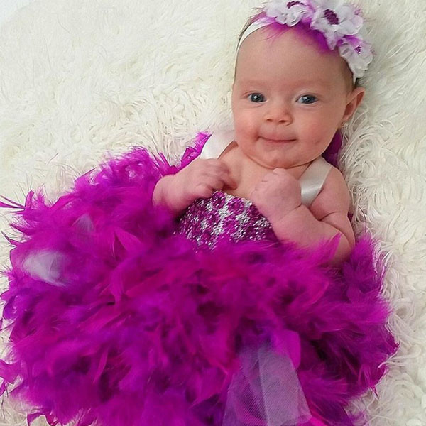 4e4e5ade1 Coco's Baby Girl Chanel Rocking a Feather and Sequin Dress Will Make Your  Heart Explode