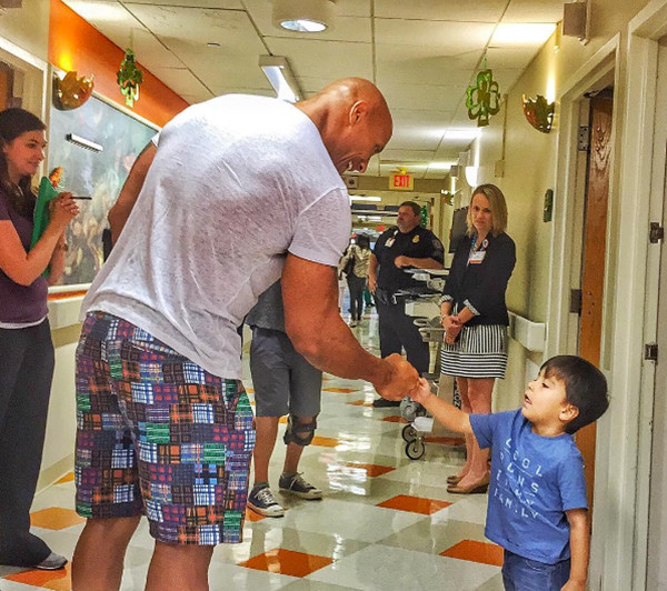 "Photos from Dwayne ""The Rock"" Johnson's Charity Work - E! Online  - UK"