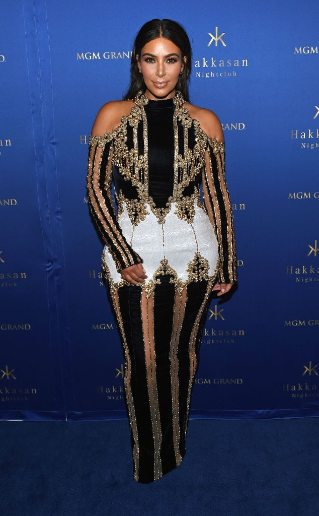 Vegas Vixen -  Just a few months after giving birth to son  Saint West , Kim returns to Las Vegas in an embellished dress with nude panels on the sleeves and skirt.