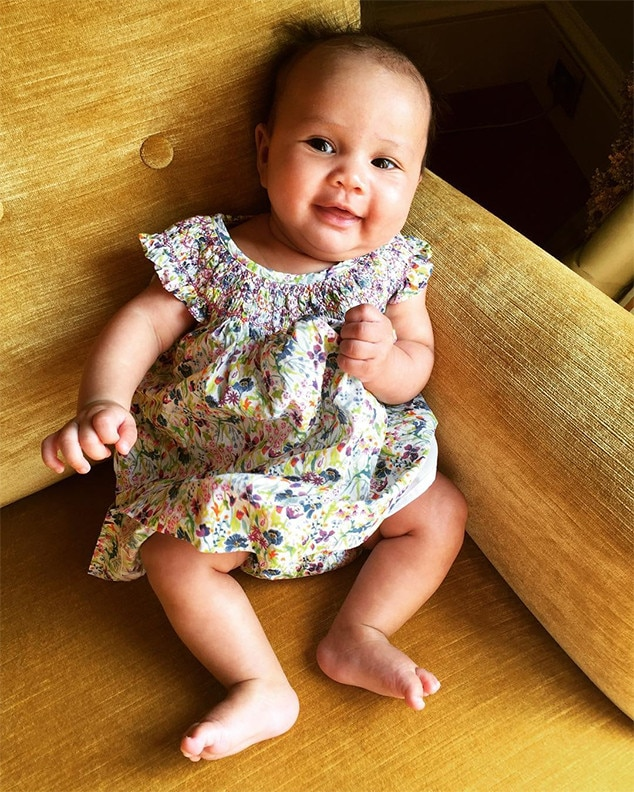 "First Vacation -  Someone is enjoying her first vacation,""  John Legend  wrote on  Instagram , weeks after he,  Chrissy Teigen  and the baby jetted off to Italy, where the couple visited the location of his ""All of Me"" music video, which stars the model, and their 2013 wedding."