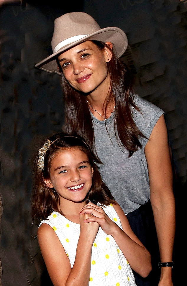 Katie Holmes & Suri Cruise -  The look-alike duo is all smiles while attending a performance of Finding Neverland  in the Big Apple.
