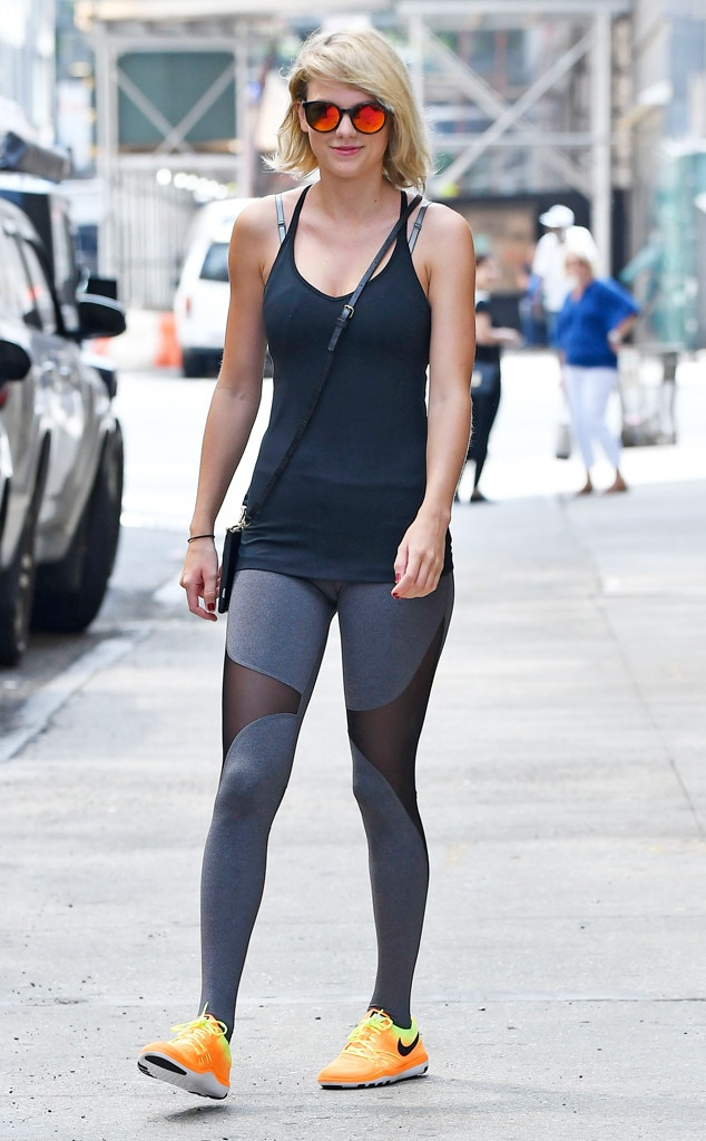 Workout Wonder -  Looking fit and fab, the 18-time Grammy-nominee walked the streets in a sleek black tank top and leggings, bright orange sneakers and reflective red sunglasses.