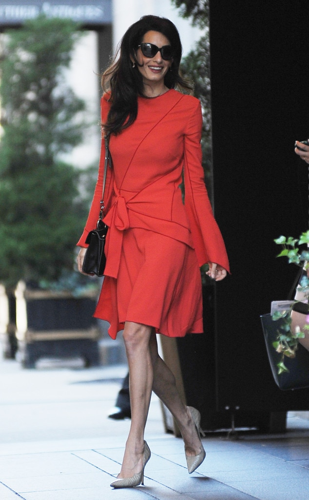 Vision in Red -  Looking fierce! Amal is hitting the road in tan crocodile Paul Andrew Zenadia pumps and a dazzling red wrap dress and we say yes queen!