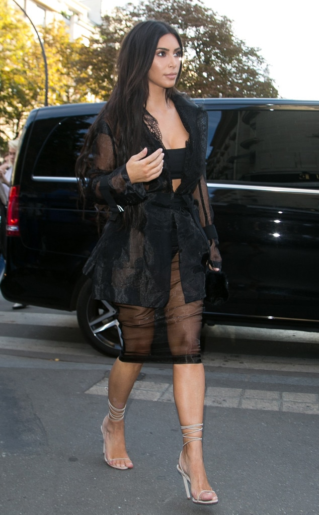Très Chic -  Kim hits Paris Fashion Week in this chic sheer skirt with a belted see-through coat over a literal censor bar.